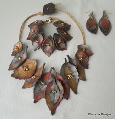 Leather? porcelian clay?...jtr  Autumn Leaves design in russet, pewter and golds
