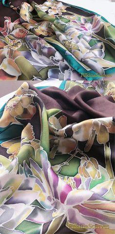 Hand Painted Silk Scarf Water Lilies Orchids by FilkinaScarvesLuxurious Floral Silk Satin Chiffon scarf with Water Lilies in a pale purple, Orchids in dark orange, purple water lilies among plants lined with petroleum stripe and dark brown background.  The fabric is 100% Natural Silk Satin Chiffon - one of the most Luxurious fabrics - exceptionally gentle, vivid and soft to touch  Silk Satin Chiffon is a delightful light weight soft to touch semi-sheer chiffon silk with an elegant satin…