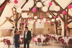 The balloons make it look all fun and playful. The high ceiling with the wood beams is a cool contrast.