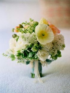 {Very Pretty Round Bouquet Showcasing: Light Yellow & Coral Poppies, White Eremurus, White Camellias, Green Hellebores, Tied With White & Aqua Organza Ribbons