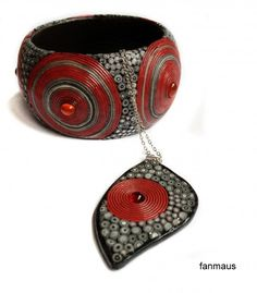 Polymer clay bracelet with red and black and gray canes. Fanmaus.