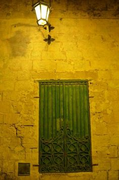 green door at night in Mdina, Malta
