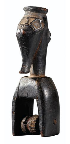 Africa | Heddle pulley from the Guro people of the Ivory Coast | Wood; dark brown patina