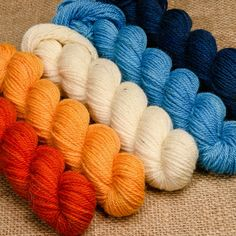 Our Elora fingering-weight mini-skeins come in sets of 5 carefully chosen hand-dyed colours, perfect for colourwork or gradient patterns. Hand Dyed Yarn, Yarns, Montreal, Spinning, Ontario, Pine, Colours, Throw Pillows, Studio