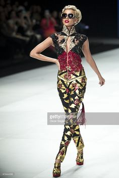A model showcases designs by Anne Avantie on the runway during Indonesia Fashion Week 2014 day 4 at Jakarta Convention Center on February 23, 2014 in Jakarta, Indonesia.