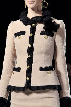 CHANEL Pink & Black Classic I like the use of ruffled fabric on the collar, and the shaped pockets, it gives it an unique look.