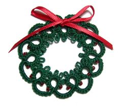 Tatted Christmas wreath pin. $5.00, via Etsy.