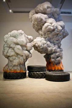 """""""Fire Tire"""" (2010), by Gal Weinstein. (wax, wool, polyester wool, styrofoam, graphite)"""