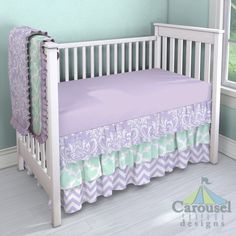 Crib bedding in Lilac Osborne Damask, Mint Large Quatrefoil, Lilac and White Zig Zag, Purple Dots, Solid Lilac. Created using the Nursery Designer® by Carousel Designs where you mix and match from hundreds of fabrics to create your own unique baby bedding. #carouseldesigns