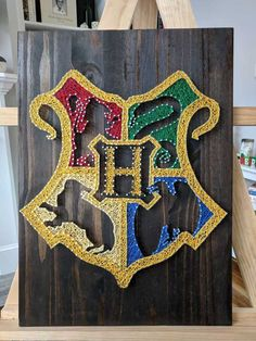 I made this Hogwarts crest string art! - Imgur
