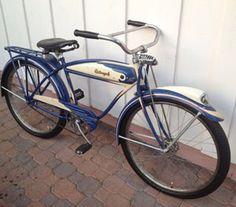 1941 Schwinn Straight-Bar Autocycle:  Cobalt blue & cream w/red pinstripes.  sold for 2,900 ebay