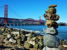 A rather tall stack of rocks were carefully balanced one of top of another and the Golden Gate background made this image very beautiful. Not only this, but there are two bridges in the picture which gives it an interesting twist. Architecture Courtyard, Architecture Logo, Architecture Graphics, Landscape Architecture, Print Pictures, Tower Bridge, Urban Design, Golden Gate Bridge, California