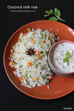 coconut milk rice is a simple, quick & delicious one pot rice made with rice, coconut milk, spices & herbs. #coconutmilkrice #kobbariannam