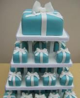 Square Mini Cakes  Cupcake towers in lieu of wedding cakes have been around for awhile, but brides are making cupcakes   interesting again by playing with shape and size. Brides are stacking square shaped mini-cakes (slightly larger than cupcakes) adorned with flowers or dressed as presents for a completely different take on the cupcake frenzy.