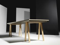 It might look like an ordinary wood conference table, but the oak slab absorbs heat and releases it when the room cools down.