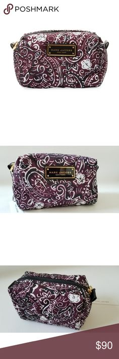 "BNWT Marc Jacobs cosmetic bag Cosmetic case. Printed polyester. Designer logo embossed metallic detail at front. Zip top closure. Body length 7"", height 41⁄4"", width 41⁄2"". 100% polyester Marc By Marc Jacobs Bags Cosmetic Bags & Cases"