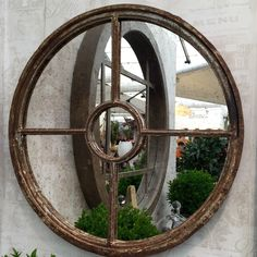 Rustic circular piece with our hand antiqued glass mirror ..