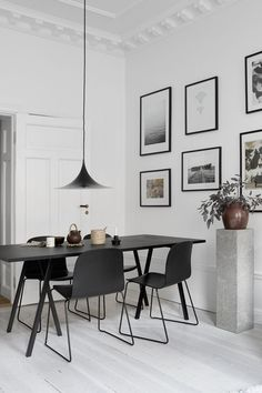 I like the soft look of this home combined with the strong contrast of the black furniture with the white walls and floors. I find the pedestals in the living room interesting as well. Something you u