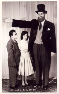 """Johann Petursson (1913-1984)  The Icelandic Giant  Billed as the Icelandic or Viking giant, Petursson grew to an impressive height of eight feet, eight inches. He was known for dressing as a viking (hence the name """"the viking giant"""") He also appeared in the movies Prehistoric Women, and Carny. (picture postcard)"""