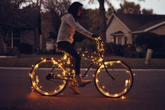 Use battery operated light strands to make a sparkly bike. Great for late night rides like trick or treat!
