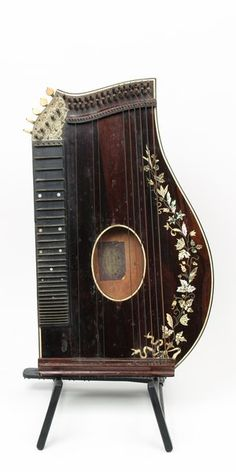 Unusual Boston made guitar Zither with Bay State John Haynes guitars, banjos, mandolins label intact. Bound rosewood, with beautiful vine pearlwork on top. Back has some ware, with ivory feet missing.