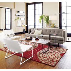 The floor to ceiling windows, natural color pallet with a pop of color, the hints of black, the railing...open and airy.
