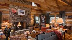 """Open wooden rafters and a stone walled floor to ceiling natural fireplace give off the """"open"""" feeling of the wildness but inside.  Love it!"""