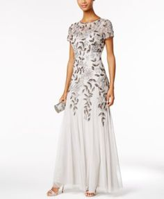 Emulate Hollywood glamour in this enchantingly embellished floor-length gown by Adrianna Papell. | Polyester; lining: polyester | Spot clean | Imported | High illusion neckline | Concealed back zipper