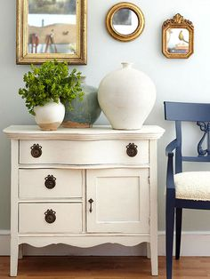 Fill an empty wall with flea market mirrors in varying sizes, but in the same color.