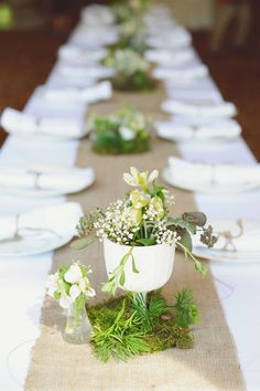 Love this setting, especially the simple white feeling with the organic burlap/linen runner.