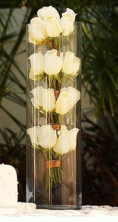 Cute centerpiece idea for tall vases.