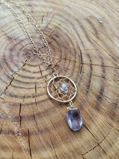 - Raw quartz crystal - gold plated dream catcher charm and adjustable chain - Please note every crystal varies in size and properties. - Adjustable, can be worn long or as a choker - Handmade In Malib