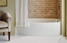 "Kohler's 5' x 30"" 'Expanse' model may be compact, but its clever, space-saving design allows plenty of extra room to stretch out and soak. The tub's graceful, curved lines coordinate with both modern and traditional decor"