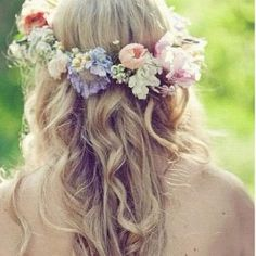 A crown of pastel flowers compliments soft curls.