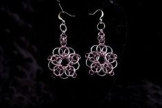 Flower Earrings. They are 1.5 inches long.