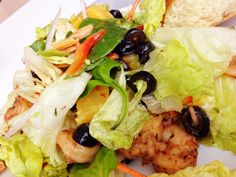 Jerk Shrimp Salad: spicy shrimp served on a bed if mixed greens, mandarin oranges, red onions, almonds, red bell pepper, roasted zucchini, tossed with an apricot vinaigrette.