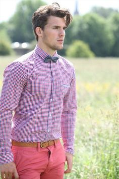 Shop this look for $90:  http://lookastic.com/men/looks/pink-dress-shirt-and-charcoal-bow-tie-and-tan-belt-and-neon-pink-chinos/3116  — Pink Gingham Dress Shirt  — Charcoal Plaid Bow-tie  — Tan Leather Belt  — Neon Pink Chinos