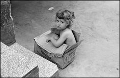 Ferdinando Scianna - ITALY, Sicily, Palermo, child in a paper box in the street.