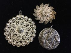 LOT INCLUDES A MOLDED DRAGON PENDANT, COSTUME FILIGREE PENDANT AND A SILVER FILIGREE BROOCH. ALL IN GOOD CONDITION.