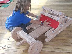 """The Dutch-designed Woodmobiel, a do-it-yourself kit of wooden parts and real tools, gets kids active again and will stimulate their creativity. With toys they build with Woodmobiel, kids can sit in their own wagon, ride on their own tricycle, lift up things from the driver's seat of their own crane, or """"fly"""" their own plane."""
