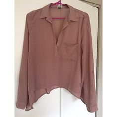 PRICE⬇️ NWOT Tobi sheer blouse NWOT Tobi sheer light pink/mauve blouse. The perfect sheer top, draped, and a bit oversized. Sleeves can be rolled up (see photos) for a more casual look. Perfect for girls night out . Offers welcome ✔️ No trades  Bundle & Save  Tobi Tops Blouses