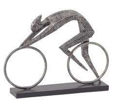 This modern abstract cyclist sculpture has a raw metallic finish and its geometric form captures the power and speed of today's racing cyclist. Modern Sculpture, Abstract Sculpture, Sculpture Art, Living Room Ornaments, Wedding Gift List, Geometric Shapes, Metal Art, Decorative Accessories, Sculpting