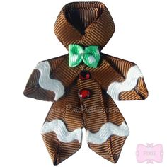 gingerbread man out of ribbon. tie another little string to it to use as tree ornament or decoration on a wrapped gift...This would make a cute hair bow for the holidays!