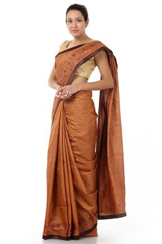 Enhance your ethnic outlook with this gorgeous brown sari, it is fashioned in kosa silk fabric with an elegant finish. This designer piece is rendered with beautiful floral detailing along the border and lends a charming appeal to your look. It comes with a complimenting blouse piece.