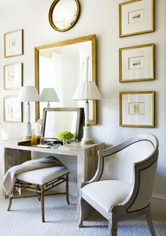 love this from marcus design    living room over sofa- round frame with burlap embroidered monogram, antiqued mirror, and matted vertical frames on sides.  Not as in your face as other random gallery ideas as far as uniformity and neutrality    entry table- round frame maybe with fabric, the double lamps set just at edges of mirror with smaller pic leaning up against it.  love it!