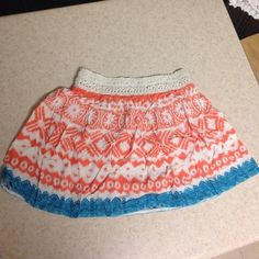 Flowy orange and blue skirt orange Aztec print skirt with blue around the bottom, cute short skirt to wear with a belt, size small from American Eagle American Eagle Outfitters Skirts Mini