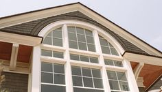 A beautiful circle top picture-style window professionally installed by The Window People. Call 203-323-1804 today to schedule a free consultation.