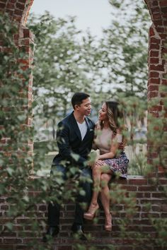 Artsy engagement photo idea - couple poses with brick wall and tree {Photo by Forever Photography}