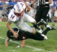 Tuslaw's Cody Brewer looks for leverage on a run as Dalton's Patrick McGinty goes for the tackle in week two of the high school football season.