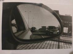 Car wingmirror, road